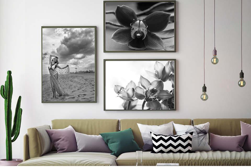 Die Wand hinter dem Sofa kann zur Galerie werden. Um die Wohnung neu zu stylen hängen Sie doch einfach mal neue Fotos auf.